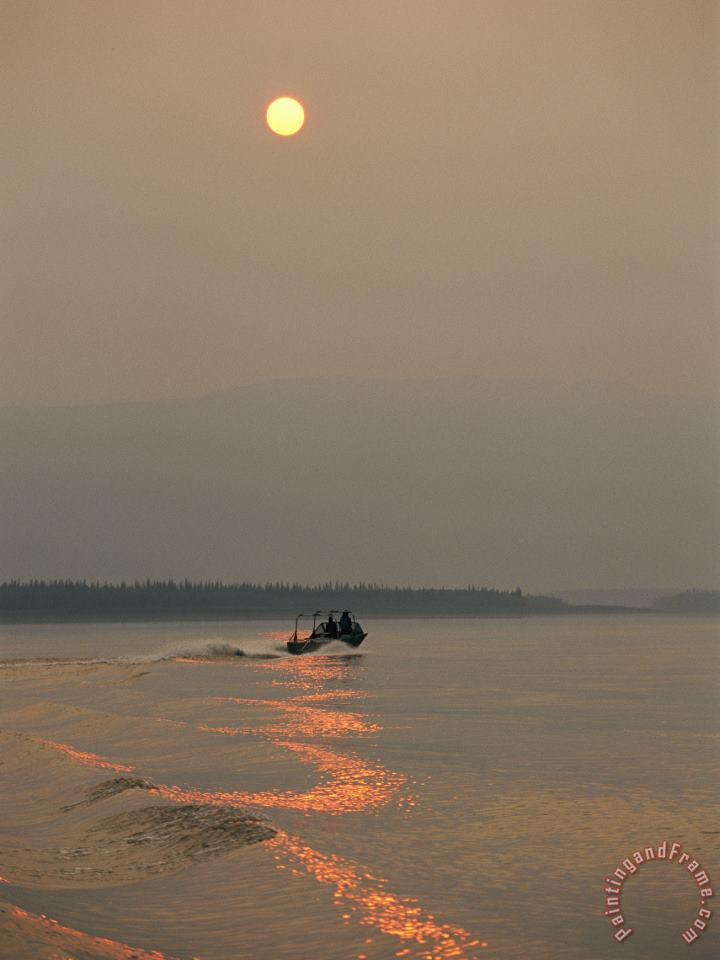 A Jet Boat Cruises Down The Mackenzie River at Sunset painting - Raymond Gehman A Jet Boat Cruises Down The Mackenzie River at Sunset Art Print