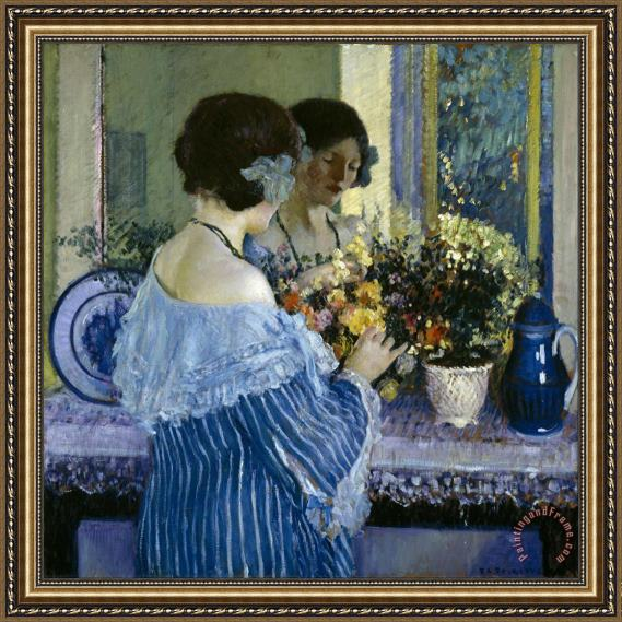 Frederick Carl Frieseke Girl in Blue Arranging Flowers Framed Print