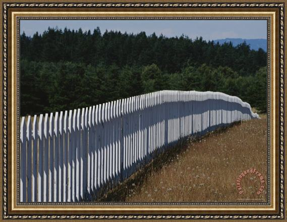 Raymond Gehman A White Picket Fence Recedes Down a Field Framed Print
