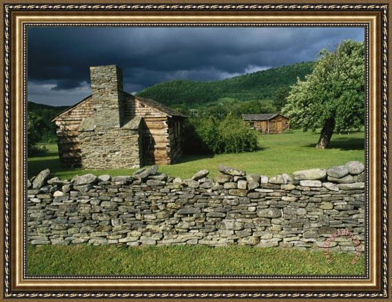 Raymond Gehman Storm Clouds Form Above Log Buildings on The Site of French Azilum Framed Print