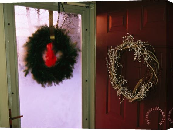 Raymond Gehman Christmas Wreaths Hanging on The Storm And Front Doors of a House Stretched Canvas Print / Canvas Art