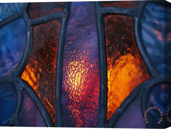 Raymond Gehman Sunset Illuminates a Stained Glass Window of a Church Stretched Canvas Print / Canvas Art