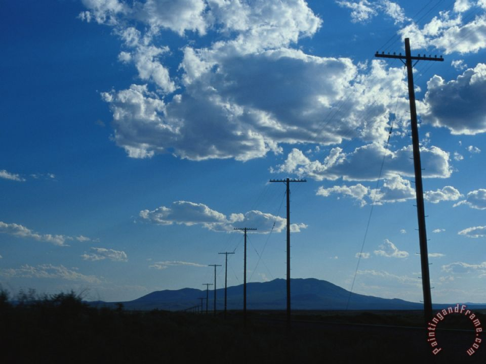 Raymond Gehman Silhouetted Telephone Poles Under Puffy Clouds Art Print