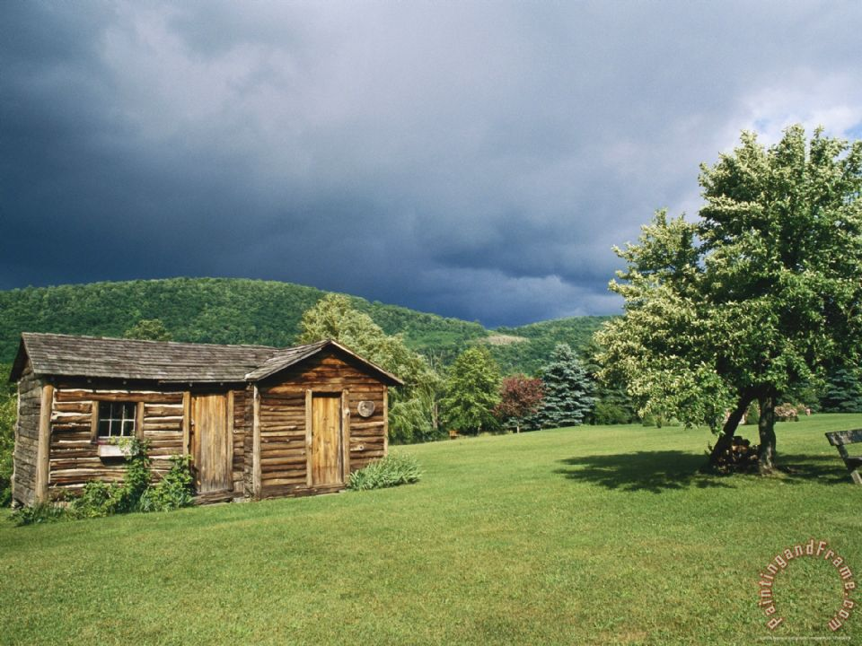 Raymond Gehman Storm Clouds Form Above A Log Cabin On The